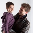 Young father and son playing together portrait. Studio shot — Stock Photo