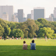 Enjoying relaxing outdoors in Central Park in New York. - ストック写真