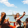Stock Photo: NEW YORK - JULY 2: Tourist on Staten Island Ferry in front of St