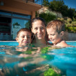 Family time in swimming pool — Stock Photo