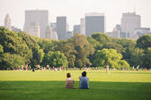 Enjoying relaxing outdoors in Central Park in New York. — Foto de Stock
