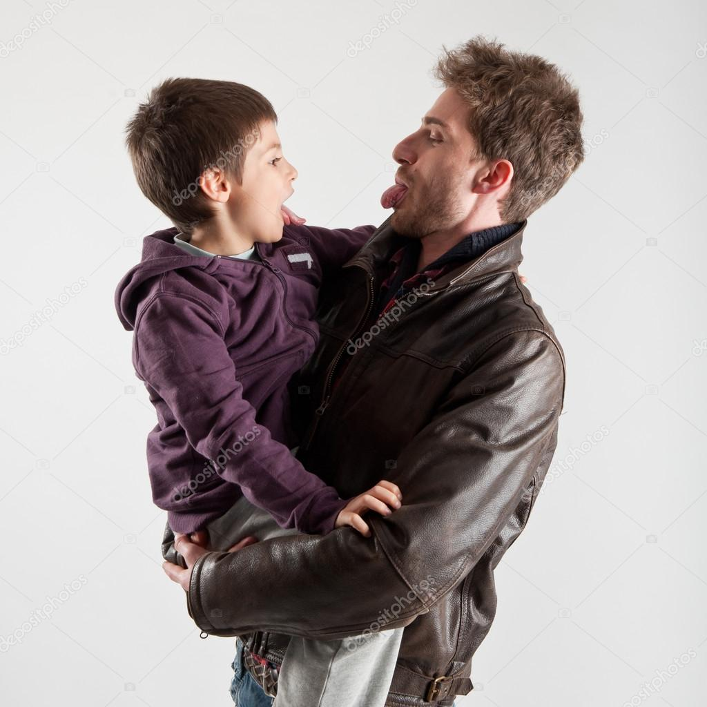 Young father and son playing together portrait. Studio shot  Stock Photo #14756549