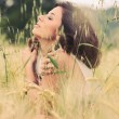 Intimate portrait of woman in golden wheat field — Stock Photo #14830887