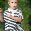 Four year old kid running outdoor - Stock Photo