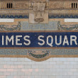 Times Square - New York city subway sign tile pattern in midtown Manhattan - Stock Photo