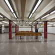 Empty interior view of Broad St. subway station in New York City - Stock Photo
