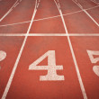 Numbers 3, 4 and 5 on running track. Perspective view - Stock Photo