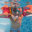Underwater little kid in swimming pool with musk and armrests — Stock Photo #14831251