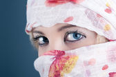 Portrait of veiled woman, focus on eyes — Stock Photo
