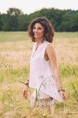 Happy woman in golden wheat field — Stock Photo