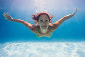 Underwater woman portrait in swimming pool — Stok fotoğraf
