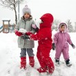 Young kids playing in the snow — Stock Photo