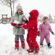 Stock Photo: Young kids playing in the snow