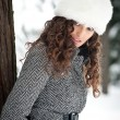 Portrait of beautiful girl in winter time nearby a tree — Stock Photo
