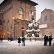 BOLOGNA, ITALY - FEBRUARY 4: enjoying snow in Neptune square in Bologna, Italy - Stockfoto