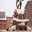 Fountain of Neptune covered by snow. Bologna. Italy - Stock Photo