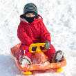 Stock Photo: Kid sliding with bob in snow