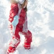 Young girl playing on the snow - Photo