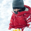 Young boy having fun in the snow - Stock Photo