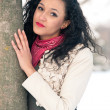 Stock Photo: Portrait of beautiful girl in winter time nearby a tree