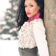 Portrait of beautiful girl in winter time nearby a tree — Stock Photo #14976671