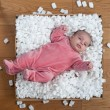 Newborn baby in a packaging box — Stock Photo