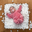 Stock Photo: Newborn baby in a packaging box