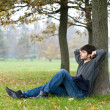 Stock Photo: Relaxed man outdoor. Intense portrait