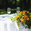 Wedding bouquet over white table outdoor — Stock Photo #14977551