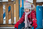 Little girl playing in winter time — Stock Photo