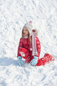 Young kid playing in the snow — Stock Photo