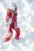 Young girl playing on the snow — Stock Photo