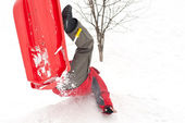 Boy falling with bob in the snow — Stock Photo