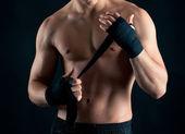Sportsman boxer intense studio portrait against black background — Stock Photo