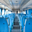Empty seats inside a train. Shallow dof - Stock Photo