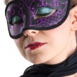 Portrait of beautiful girl with purple mask against white background — Stock Photo