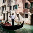 VENICE, ITALY - SEPTEMBER 31: Tourists on a Gondola, September 3, 2012 — Stock Photo