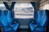 Window train with snow landscape and empty seats — Stock Photo