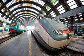 Central railway station with fast speed train waiting on the platform — Stock Photo