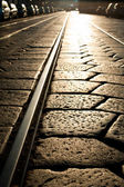 Tram rails background at sunshine. Milan, Italy — Stock Photo