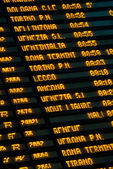 Arrival and departure board at Central railway station in Milan — Stock Photo