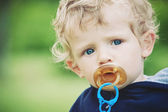 Small kid portrait with pacifier — Stock Photo