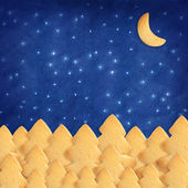 Blue sky made with homemade biscuit. Trees and Moon shape — Stock Photo