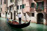 VENICE, ITALY - SEPTEMBER 31: Tourists on a Gondola, September 3, 2012 — 图库照片