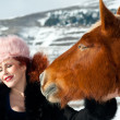 Portrait of beautiful woman and red horse in winter landscape — ストック写真
