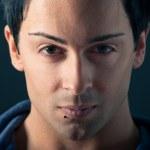 Close up portrait of handsome, confident man on dark background — Stock Photo #15652419