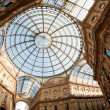Glass dome of Galleria Vittorio Emanuele II shopping gallery. Milan, Italy - Stock Photo