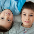 Two brothers portrait laying on bed — Stock Photo