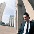 Confident young businessman portrait in a office building background — Stock Photo