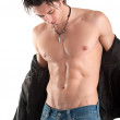 Portrait of confident young man shirtless against white background — Stock Photo